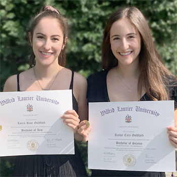 Identical twins graduate with gold medal honour.
